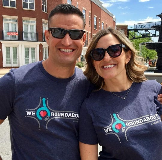 "Residents pose in ""We (heart) Roundabouts"" shirts, one piece of Carmel's National Roundabout Week celebration. The shirts will be sold at All Things Carmel, 110 W Main St."