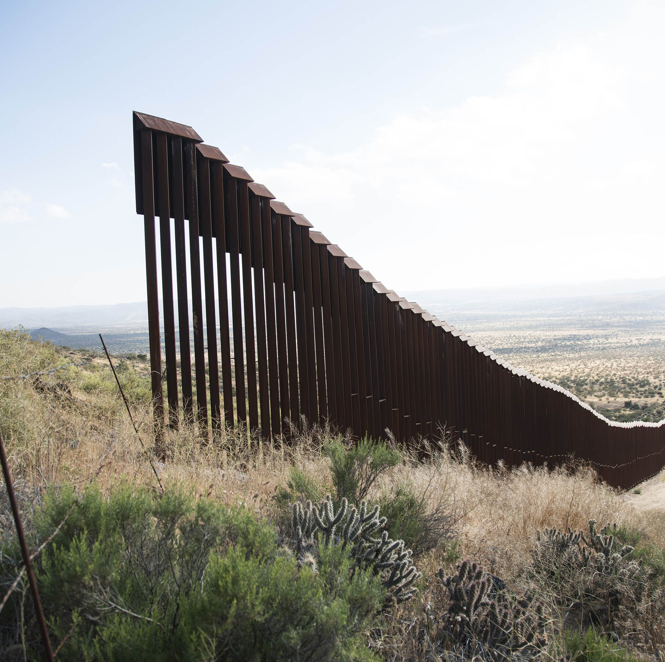Gaps in the U.S.-Mexico border fence like this one near Jacumba, Calif., just east of San Diego, appear in places along the nearly 2,000-mile border, especially where the terrain begins to get rough.