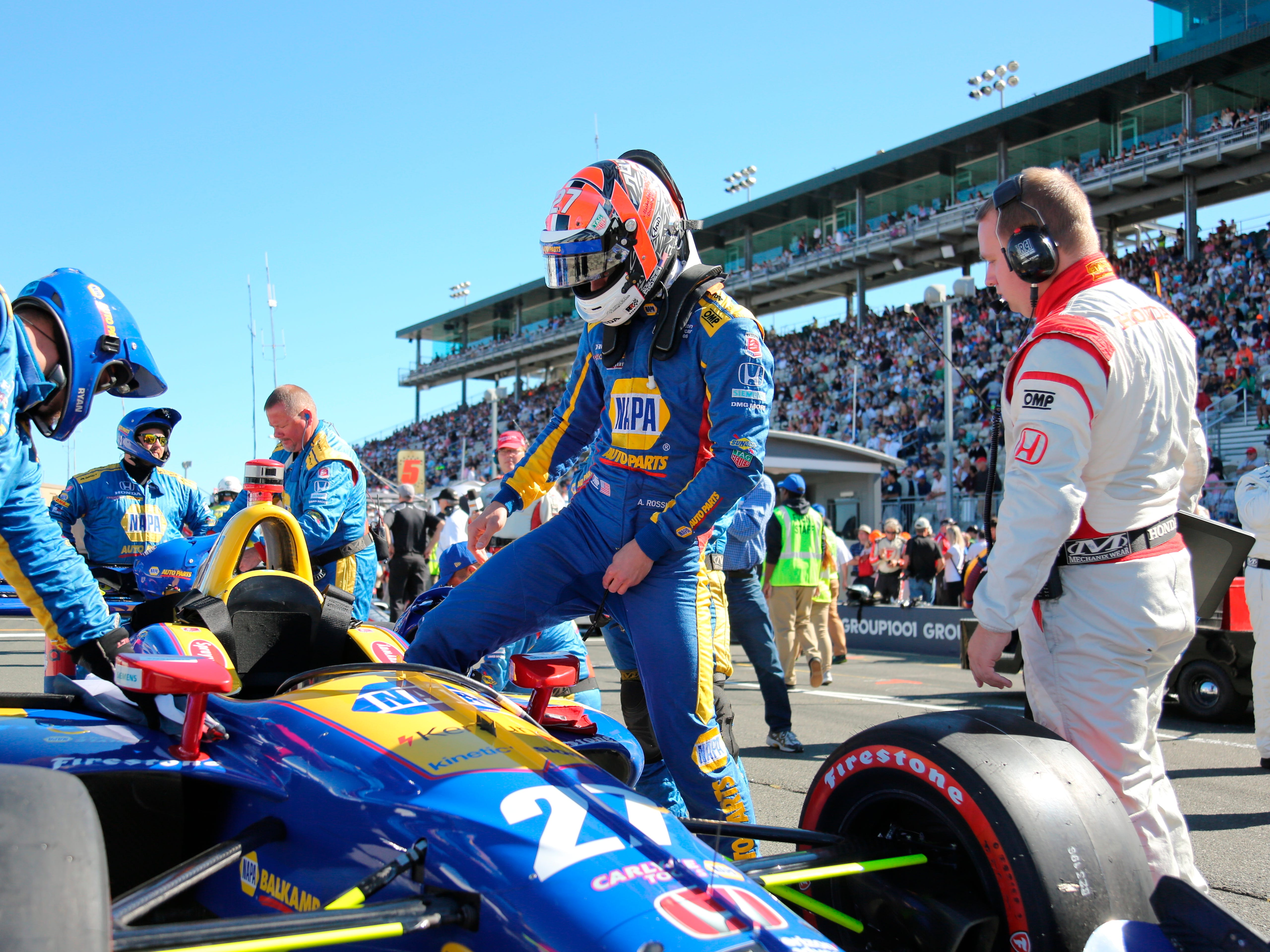 Nevada County's Alexander Rossi readies to step into his IndyCar during his last race of the 2018 Verizon IndyCar Series Sunday, Sept. 16, 2018 in Sonoma, Calif.
