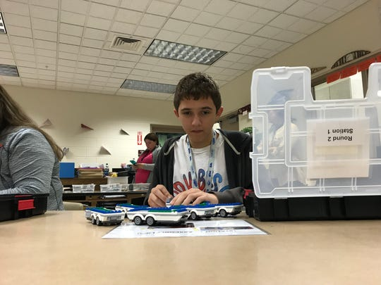 NorthWood Middle School student Mikel Renze puts together miniature recreational vehicles.