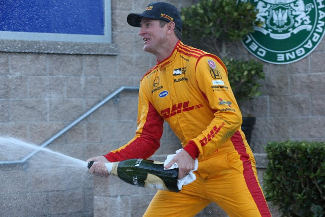 Ryan Hunter-Reay celebrates with a champagne spray in Victory Lane after winning the 2018 INDYCAR Grand Prix of Sonoma at Sonoma Raceway