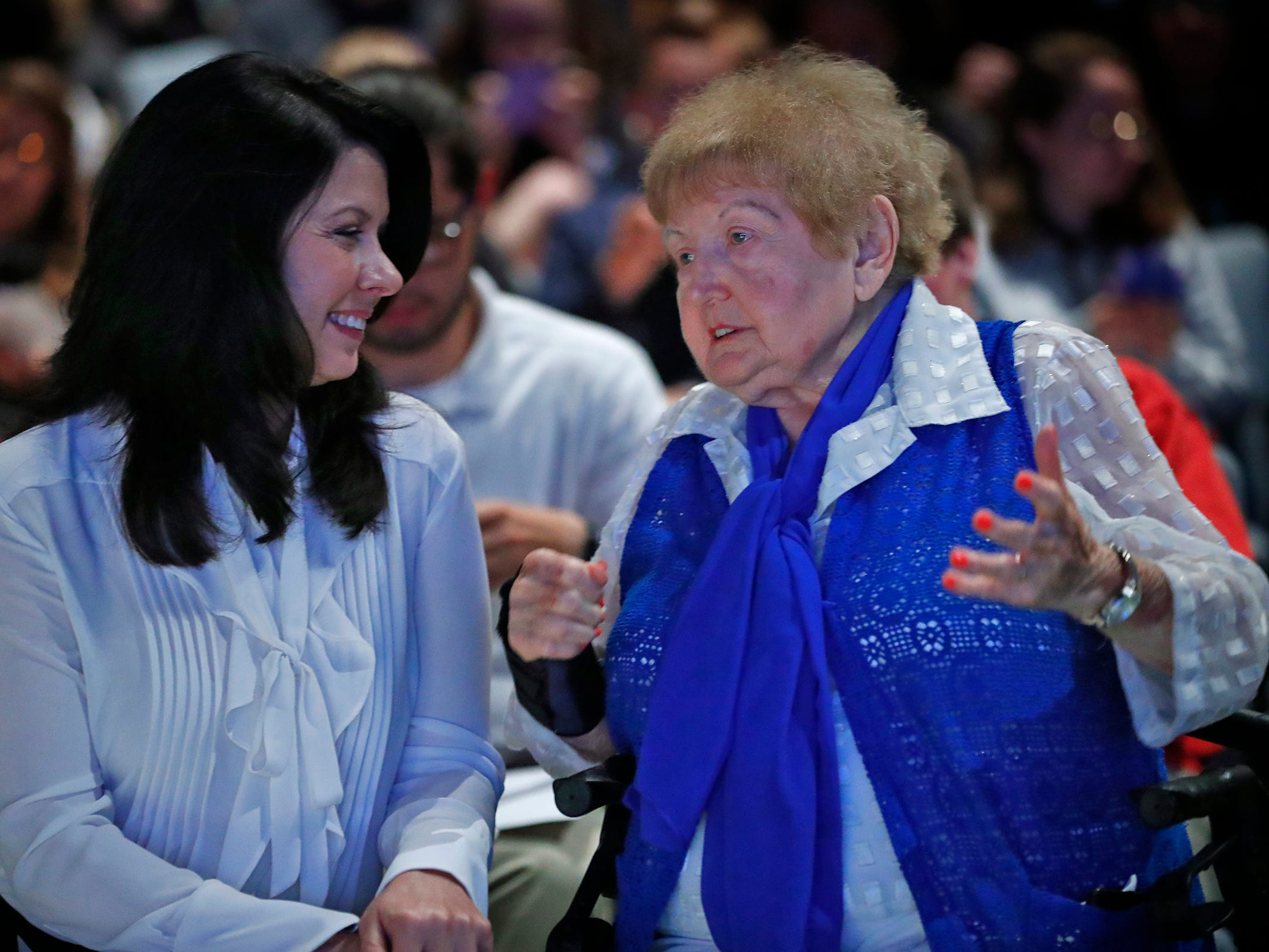 """Holocaust survivor Eva Kor, right, speaks with Indiana First Lady Janet Holcomb after the viewing of """"Eva,"""" at Newfields, Monday, Sept. 17, 2018.  Students viewed the documentary """"Eva,"""" about Kor, and then helped in the planting of the Eva Kor Peace Garden.  Kor also spoke with the students, asking them to think of one thing to make the world better."""