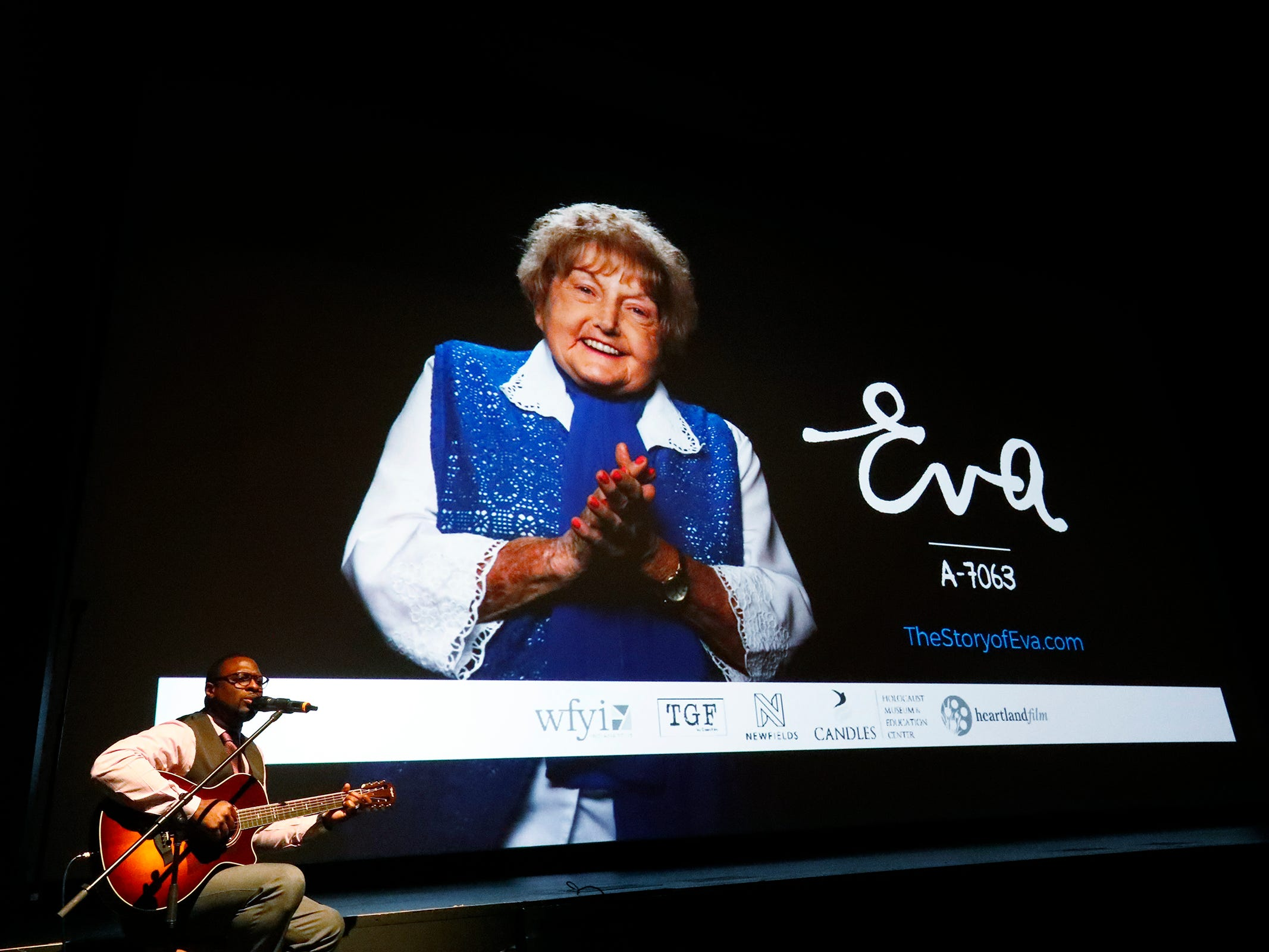 """Tyron Cooper plays the guitar after a viewing of the """"Eva,"""" at Newfields, Monday, Sept. 17, 2018.  Students viewed the documentary, about  Holocaust survivor Eva Kor, and then helped in the planting of a Peace Garden.  Kor also spoke with the students, asking them to think of one thing to make the world better."""