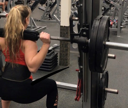 At 5-5, 135 pounds, Stormy Kotzelnick squats 225 pounds six reps.
