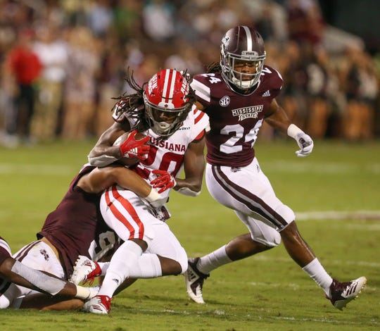 Mississippi State's Montez Sweat (9) brings down Louisiana's Jarrod Jackson (20) as Mississippi State's Chris Rayford (24) closes in. Mississippi State and Louisiana played in a college football game on Saturday, September 15, 2018, in Starkville. Photo by Keith Warren/Madatory Photo Credit