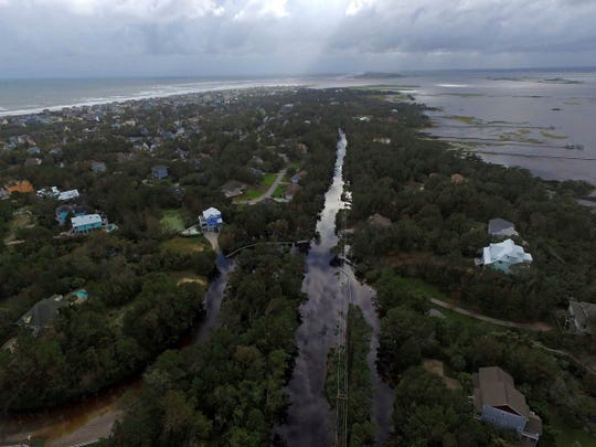 Coast Guard Road leading to the south end of Emerald Isle is seen after Hurricane Florence hit Emerald Isle, N.C., Sunday, Sept. 16, 2018.