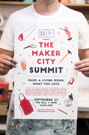 David Harman of Native Maps holds one of the Maker City Summit posters he screen printed. The poster was designed by Maranda Vandergriff.
