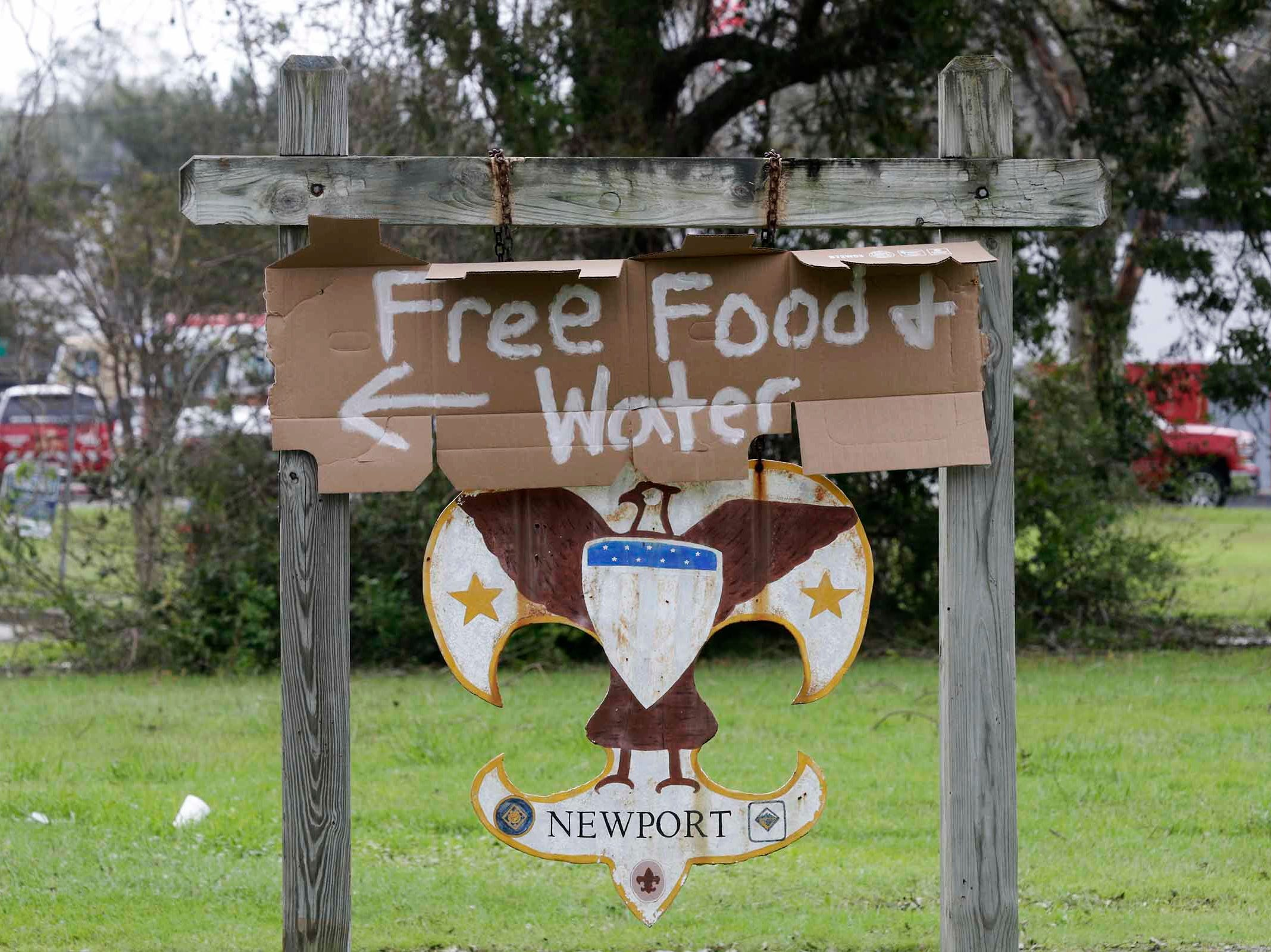 A Boy Scout hut sign offers free food and water after Hurricane Florence hit the Newport N.C., area on Monday, Sept. 17, 2018.