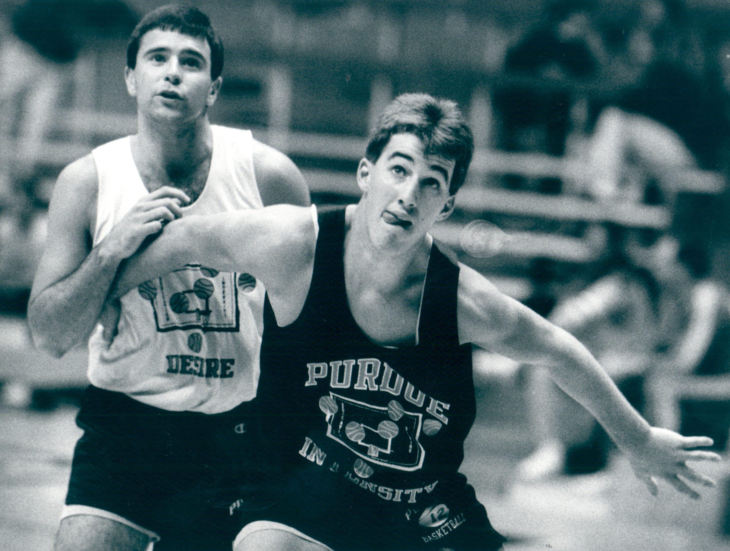 Dave Barrett, left, battles with current Purdue basketball coach Matt Painter during a 1990 practice.