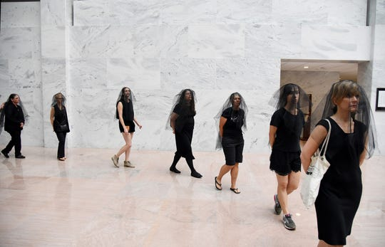 Women in black veils protest outside of the Brett Kavanaugh confirmation hearing in the Hart Senate Office Building Friday, Sept. 7, 2018 in Washington, D.C.