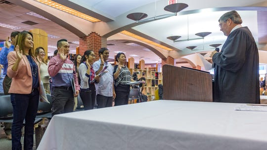 Citizenship Day is marked by 15 people taking the Oath of Allegiance and become naturalized U.S. citizens. Monday, Sept. 17, 2018.