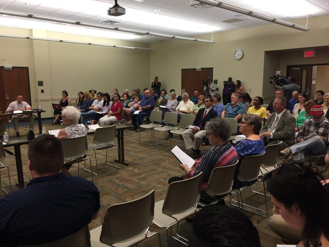 A large crowd gathered at the Lafayette Public Library Monday night to speak to the board of control.
