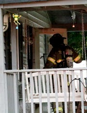 Firefighters walk into a home Monday afternoon, Sept. 17, 2018, in the 13000 block of Queen Road Northeast in Walnut Township. The home's resident Tony Vohsine said the house was full of smoke when he get home from work. Millersport Fire Chief Bob Price said a cause of the wasn't immediately known.