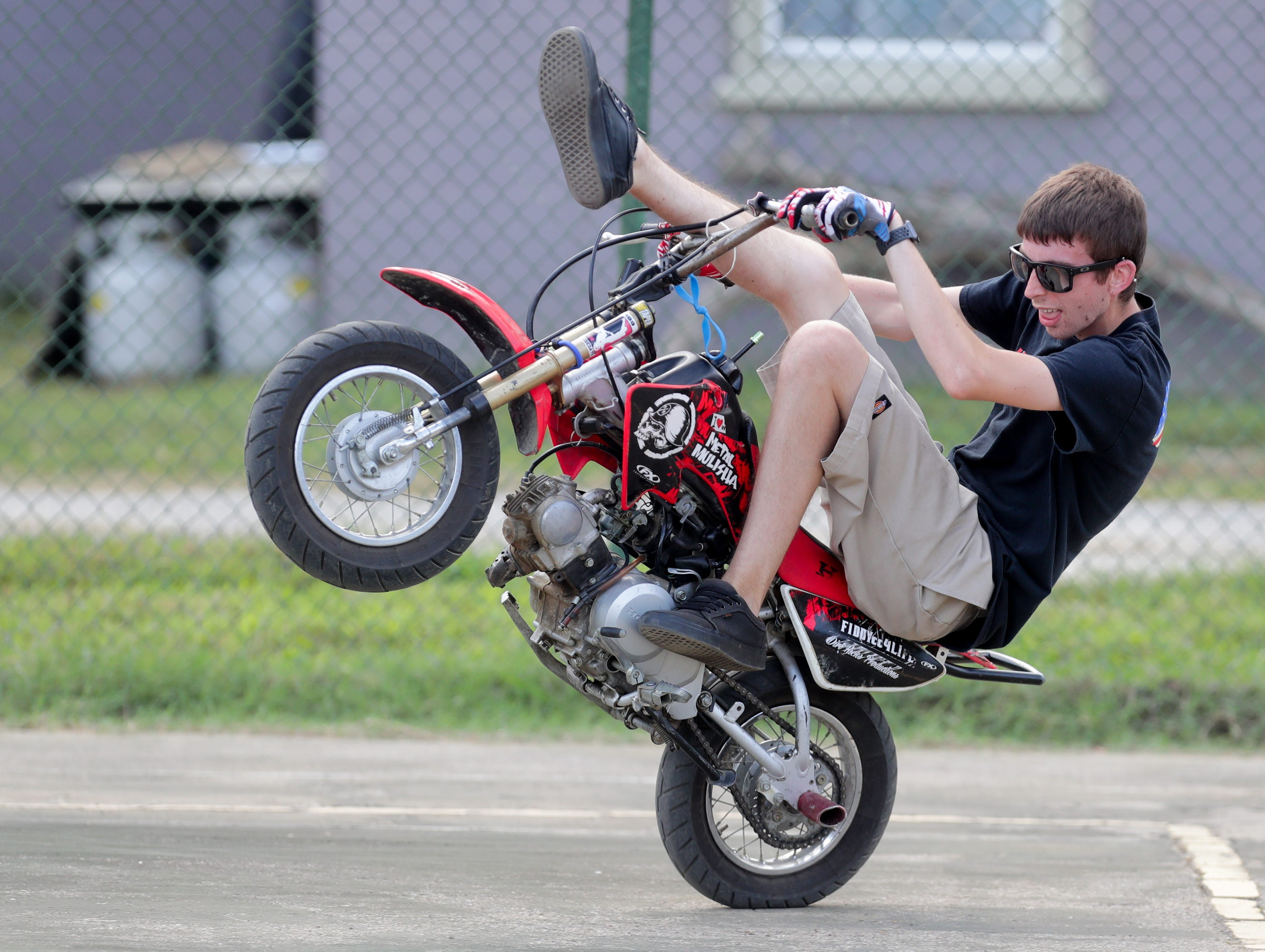 Jordan Thomas performs tricks in the stunt area of the Kentucky Kick Down Festival.