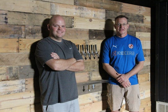 Joe VanBuskirk, left, and Tim Chambers, right, hope to open a taproom in Marion's downtown by late fall or winter. The co-owners bought the building at 151 S. Main St. last year and have been working on converting it into the Marion Brewing Company for about a year.