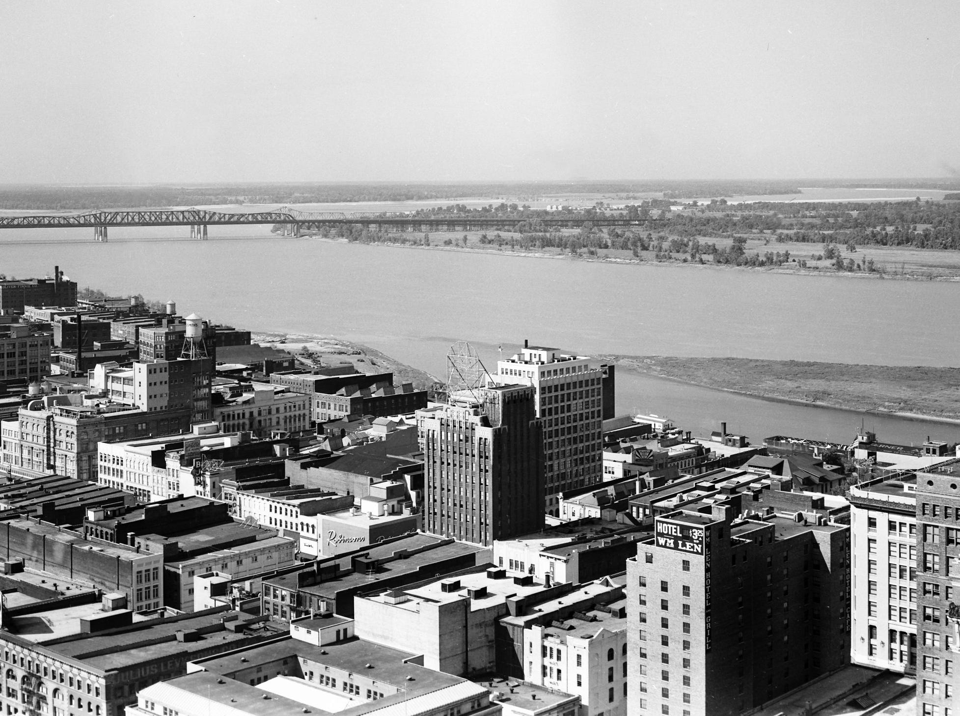 The most spectacular view in Memphis in September, 1951 is quite naturally from the roof of the most spectacular building in Memphis — the 365-foot Sterick Building, which opened in 1930.  Tallest building in the city, and loftiest in the South, excluding the Southwest, the 29-floor building is a small city with a great city.  For breathtaking beauty, it is hard to better this view of the lazy Mississippi River rolling by Memphis' doorstep, as caught from the building's roof.