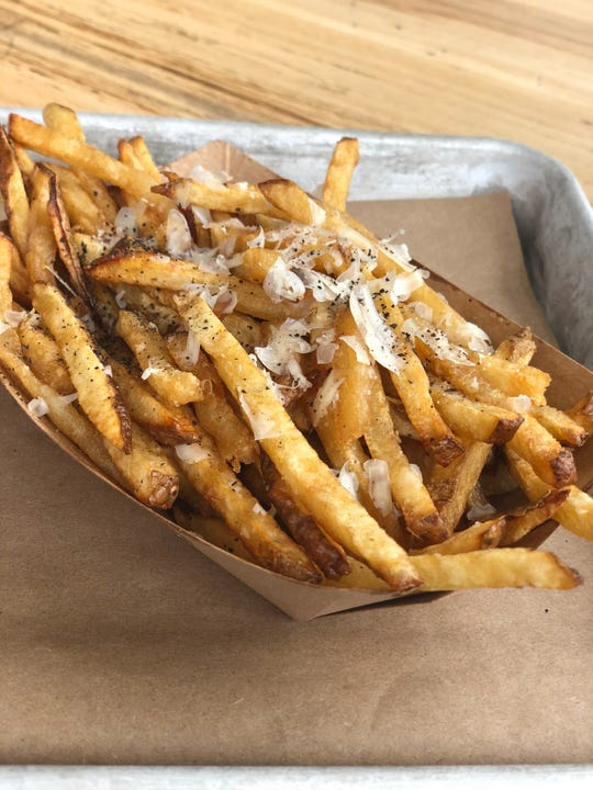 Bourgeois Style fries at Farm & Fries. These over-the-top fries are fried a second time in duck fat and then tossed with Parmesan, truffle oil, and salt.