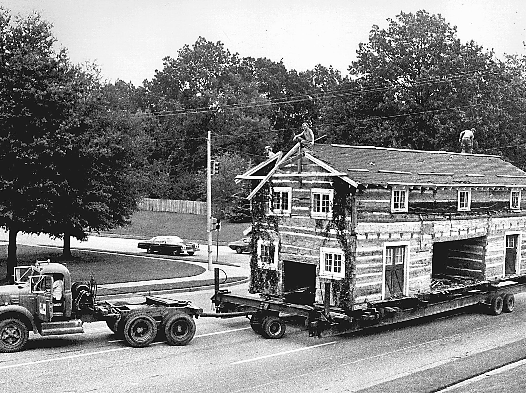 A log cabin is moved to the Libertyland site on September 16, 1975. The park, which opened on July 4, 1976, struggled through several money-losing years and closed after the 2005 season.