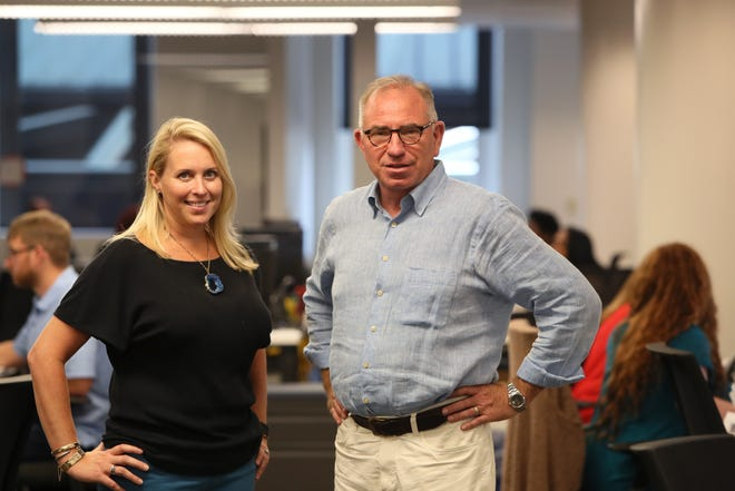 Indigo Agriculture employees Tracy Alexander, left, and Barry Knight, stand in their Downtown Memphis office. The Boston tech firm employs more than 130 workers in Downtown Memphis.