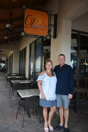 """CJ's on the Bay owners Curt and Jacquie Koon. """"The Heart of the Rock"""" will celebrate 10 years as CJ's with a party on Saturday."""