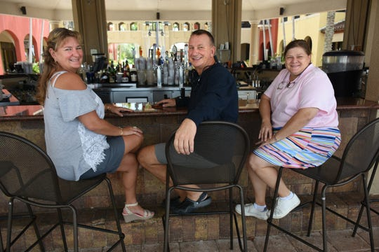 """CJ's on the Bay owners Curt and Jacquie Koon, left, with general manager Laura Owen. """"The Heart of the Rock"""" will celebrate 10 years as CJ's with a party on Saturday."""