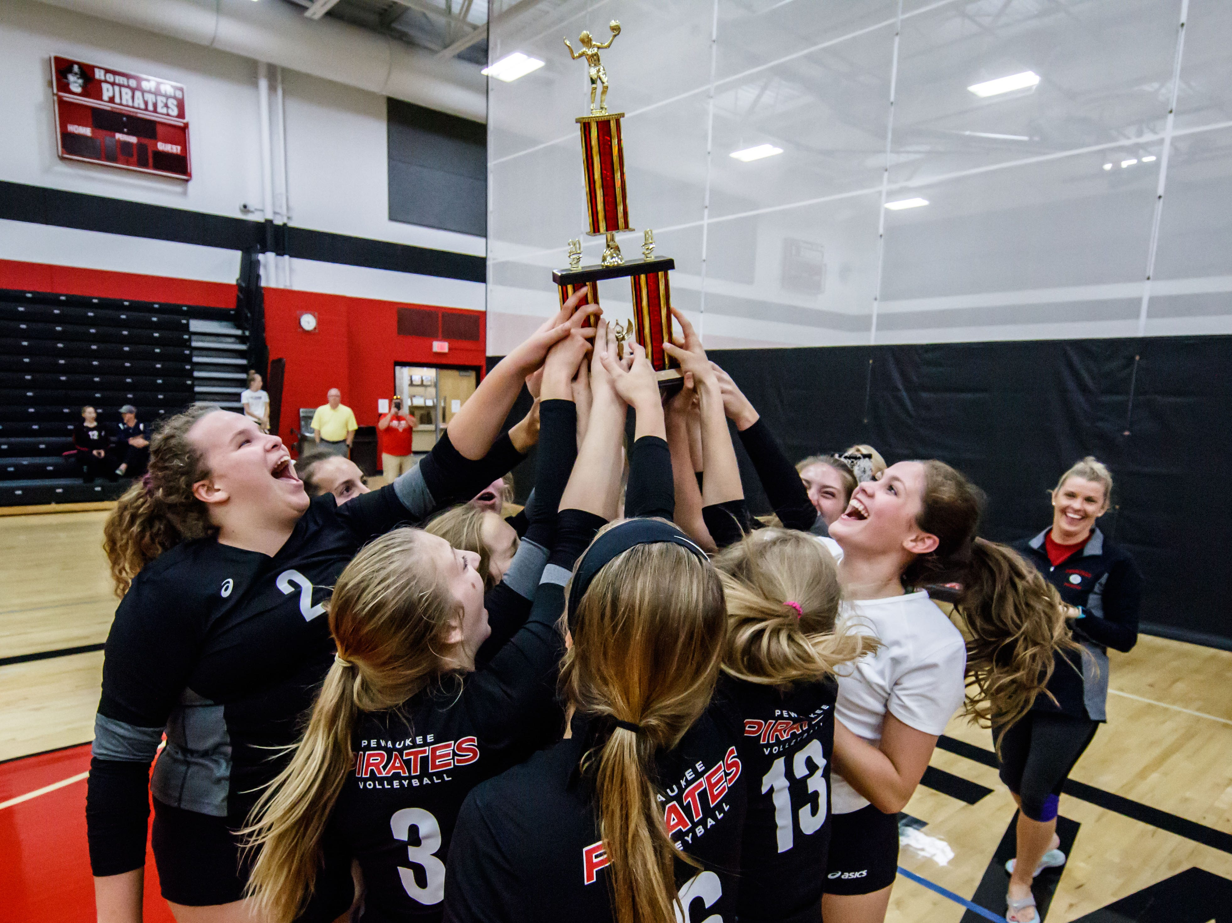 Pewaukee celebrates winning the championship match in their Lady Pirate Invitational against Notre Dame Academy on Saturday, Sept. 15, 2018. This is the first time the Pirates have won the tournament in the 18-years they have been hosting it.