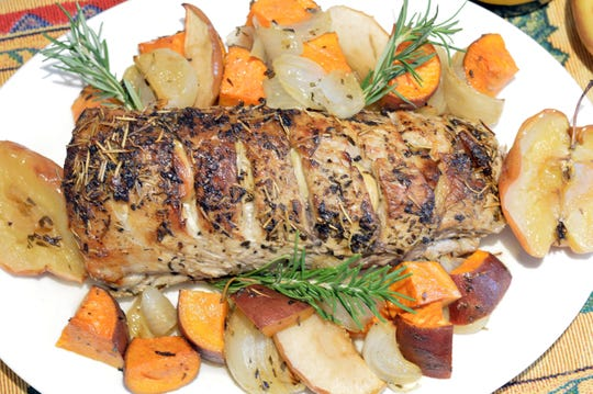 Sweet potatoes and apples enhance this roast pork loin.