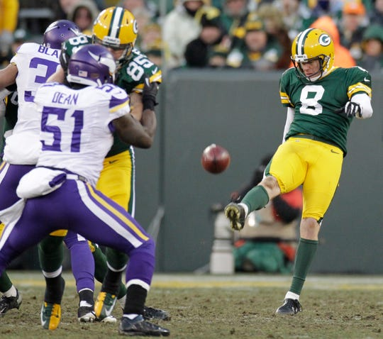 Green Bay Packers punter Tim Masthay (8) punts during their game Sunday, November 24, 2013 at Lambeau Field in Green Bay, Wis. The Green Bay Packers tied the Minnesota Vikings 26-26.