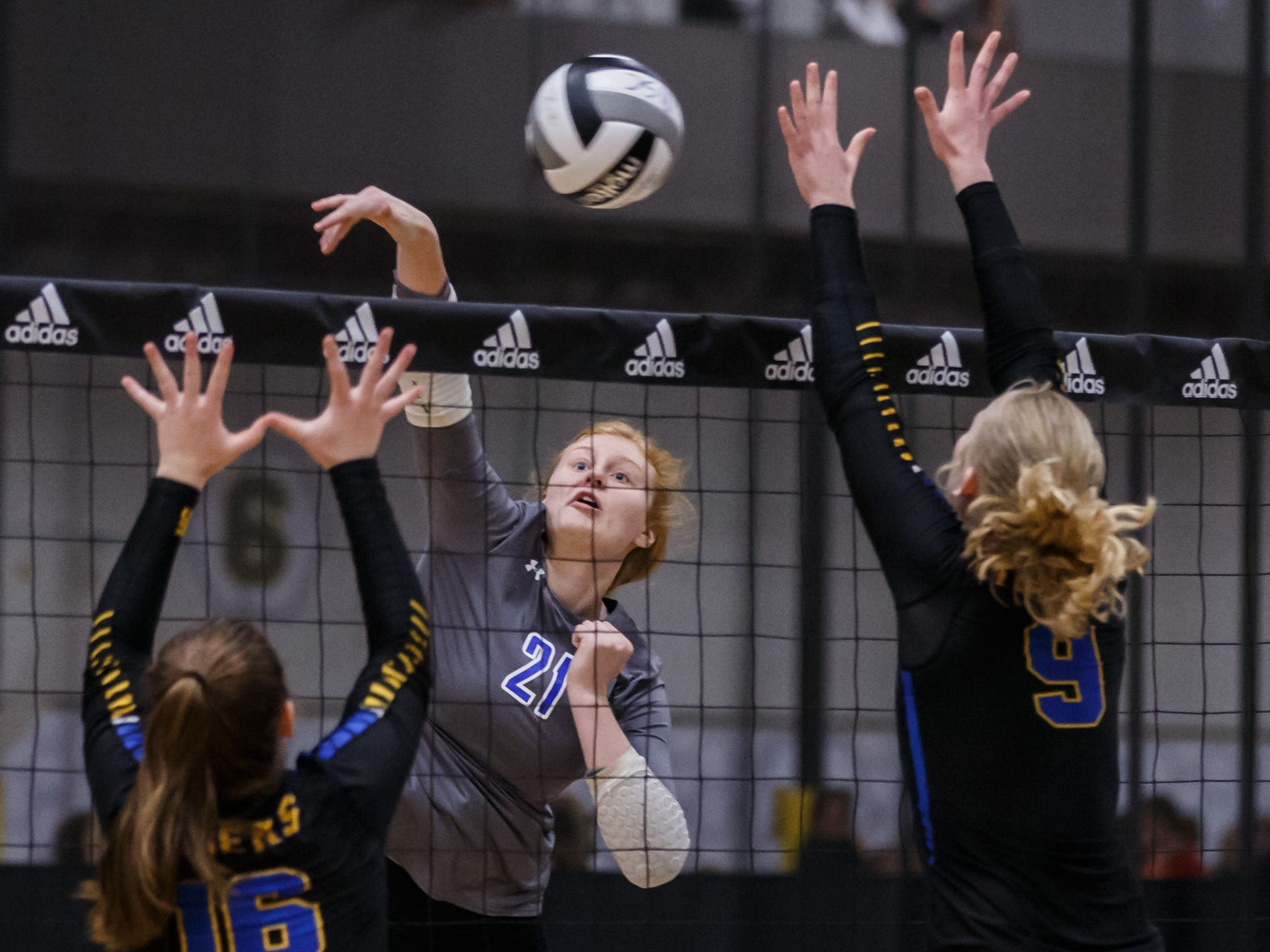 Waukesha West senior Anna Nerad (21) elevates for a kill during a match at the 2018 Eastbay Charger Challenge hosted by Sussex Hamilton at the Milwaukee Sting Center in Menomonee Falls on Saturday, Sept. 15.