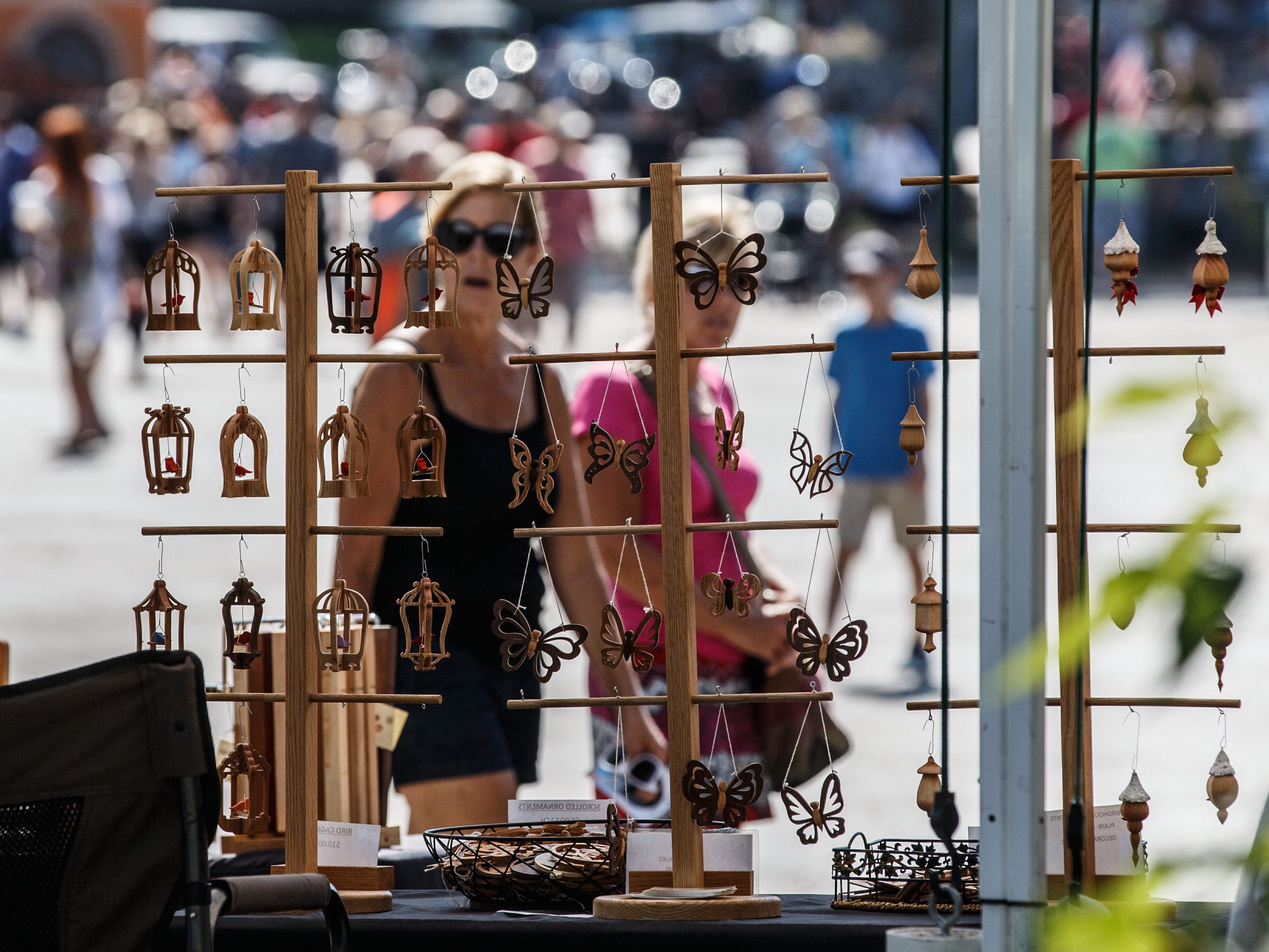 Visitors explore the Fine Arts Show behind the Cedarburg Cultural Center during the 46th annual Wine & Harvest Festival in downtown Cedarburg on Sunday, Sept. 16, 2018. The free two-day family-oriented arts and crafts event features homegrown produce, artisan foods, award-winning wines of Cedar Creek Winery, live music, children's activities and much more.