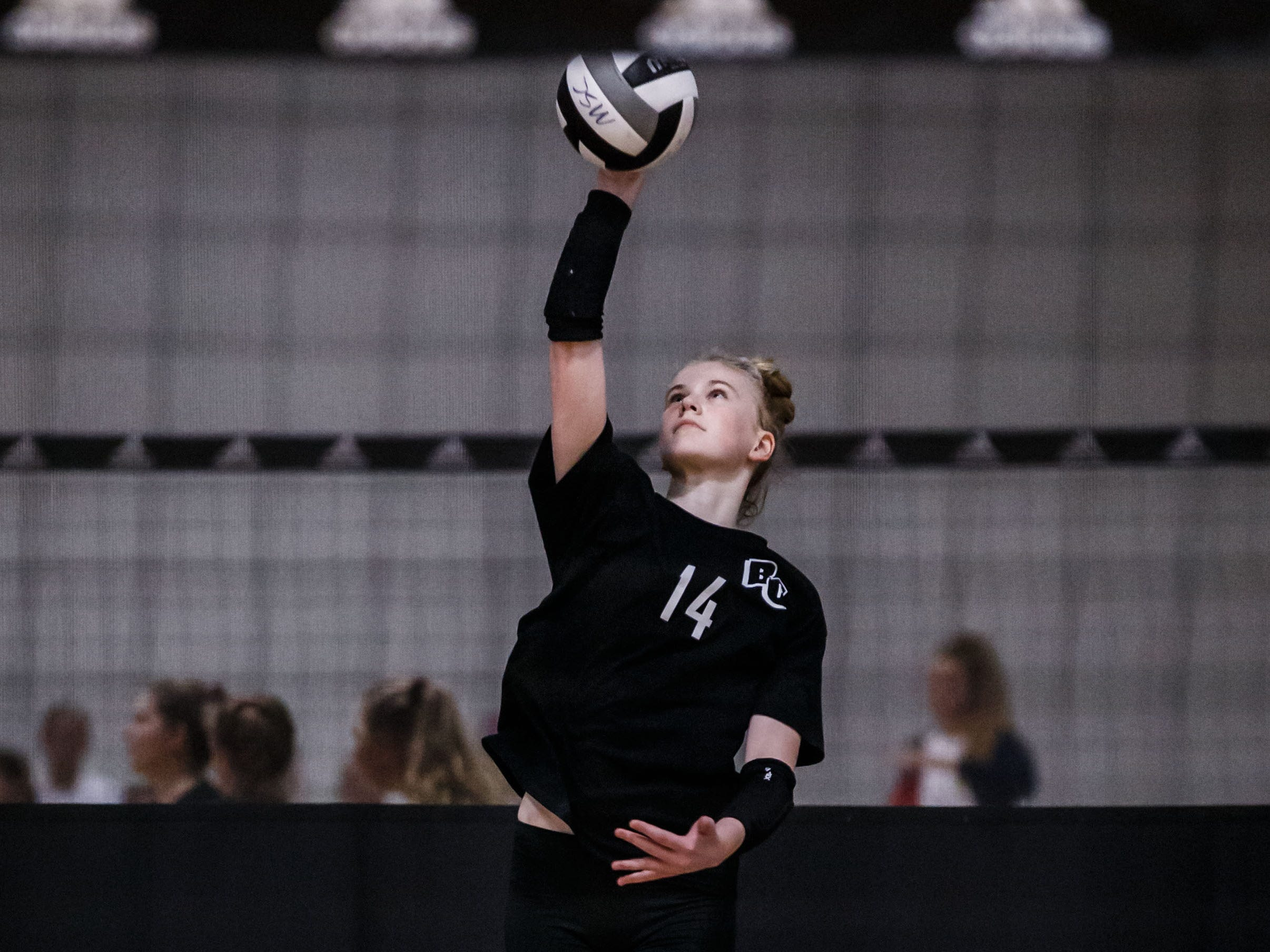 Brookfield Central freshman Mckenna Wucherer (14) serves during a match at the 2018 Eastbay Charger Challenge hosted by Sussex Hamilton at the Milwaukee Sting Center in Menomonee Falls on Saturday, Sept. 15.