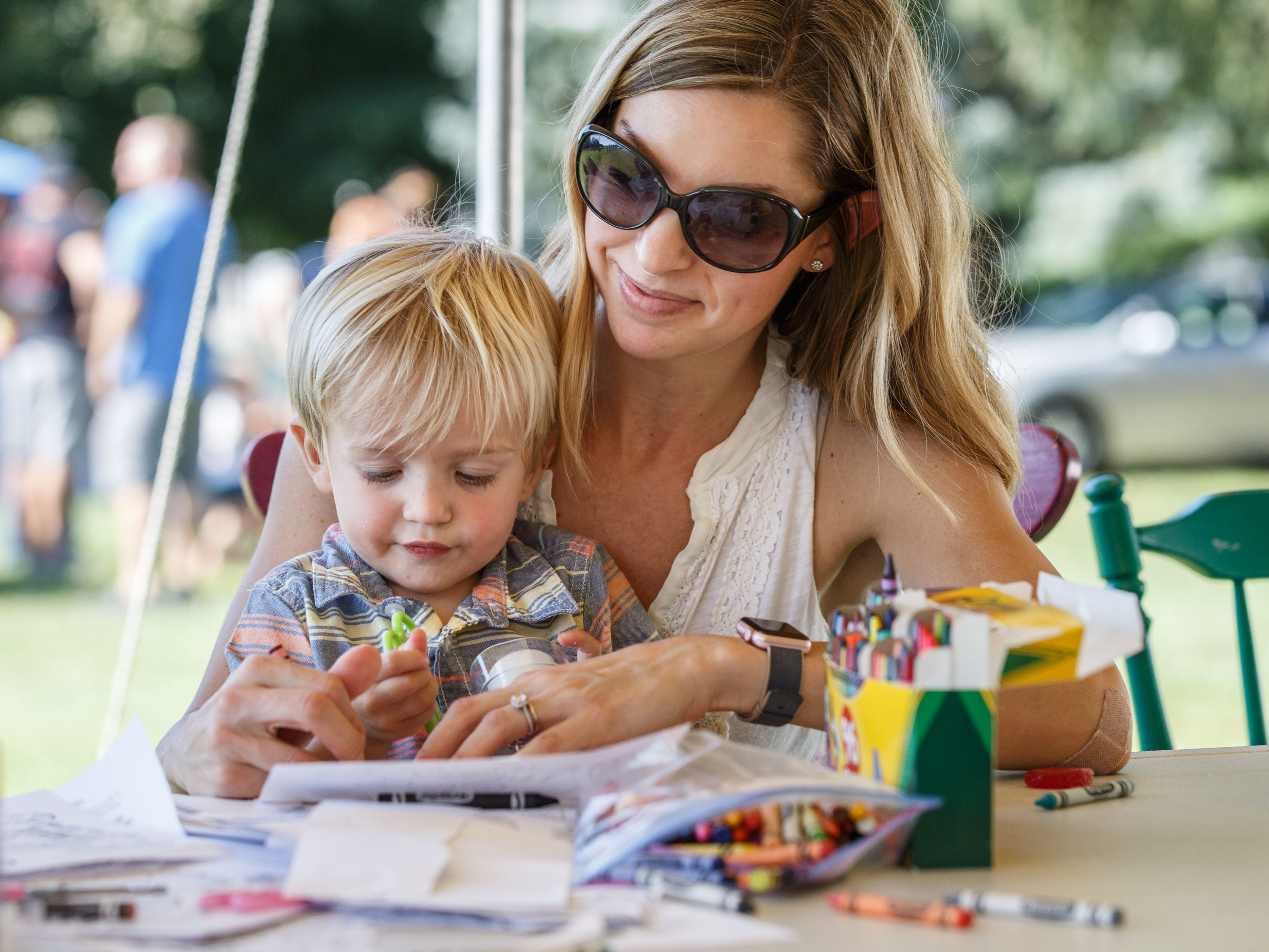 One-year-old Hank Steiner of Pewaukee works on a craft project with his mother Megan during the annual North Lake Harvest Fest on Saturday, Sept. 15, 2018. The free event includes a parade, vendor market, food trucks, live music, tractor pulls, face painting, kids activities and more.