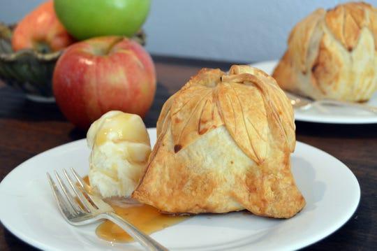 Apple Dumplings are served with ice cream and caramel sauce.