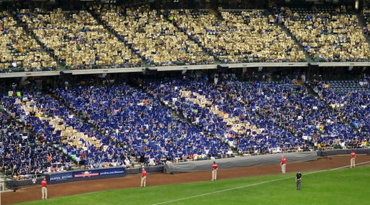 Sarah Bartosz organized an event where Brewer fans showed gold placards to support awareness of childhood cancer. Her son Jack Bartosz was diagnosed with advanced neuroblastoma when he was four years old.