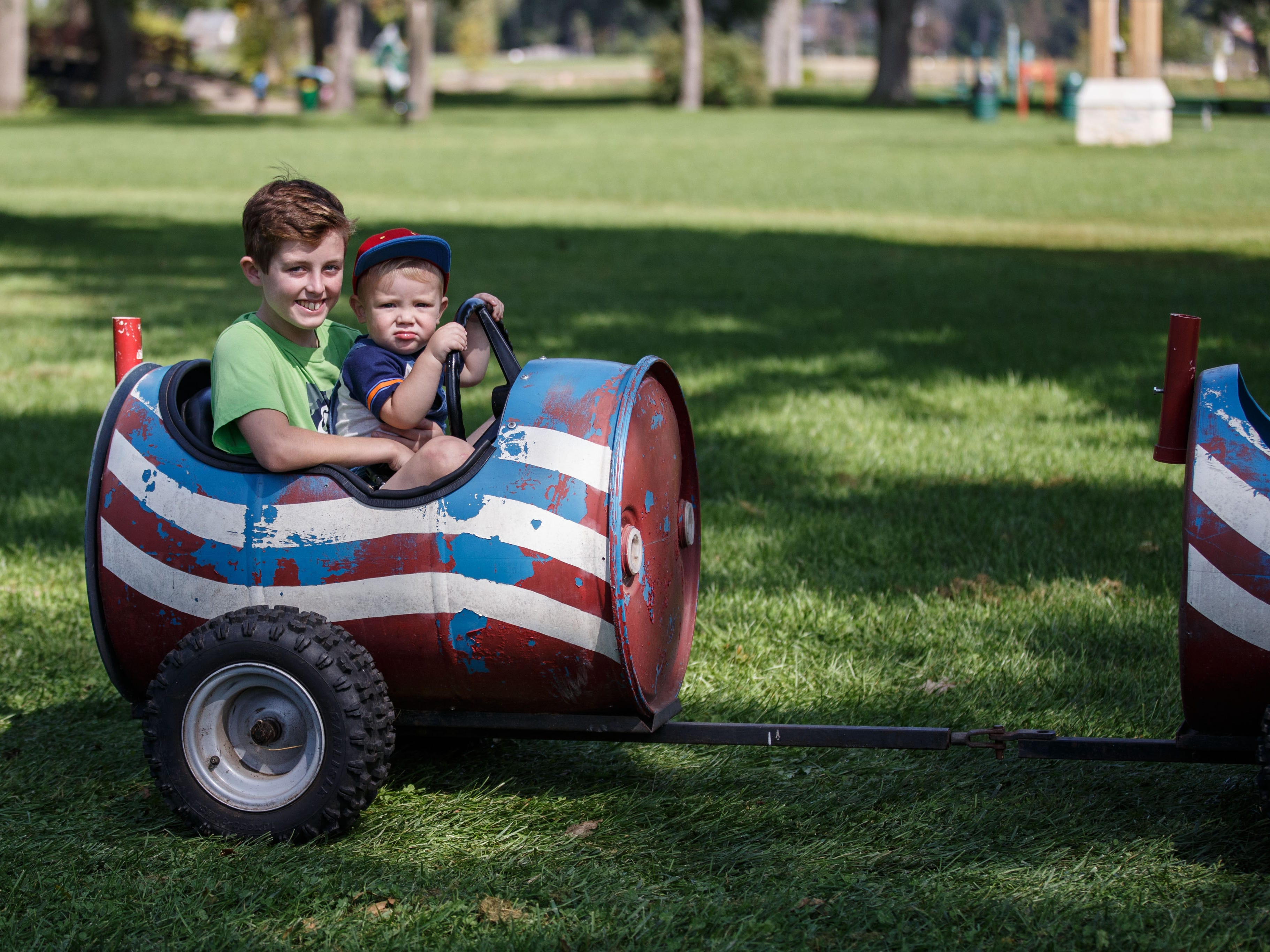 Ethan Holland, 13, of Cedarburg and his 1-year-old brother Beckett take a ride on the Cedar Creek Farm's barrel train during the 46th annual Wine & Harvest Festival in downtown Cedarburg on Sunday, Sept. 16, 2018.