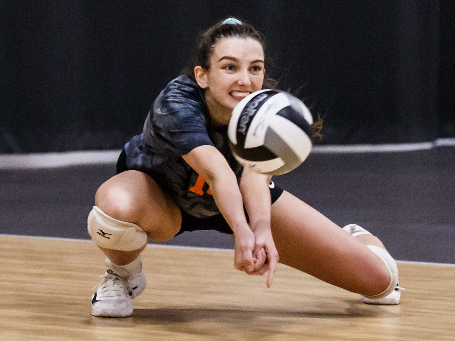Cedarburg senior Ella Martone (13) digs a serve during a match at the 2018 Eastbay Charger Challenge hosted by Sussex Hamilton at the Milwaukee Sting Center in Menomonee Falls on Saturday, Sept. 15.