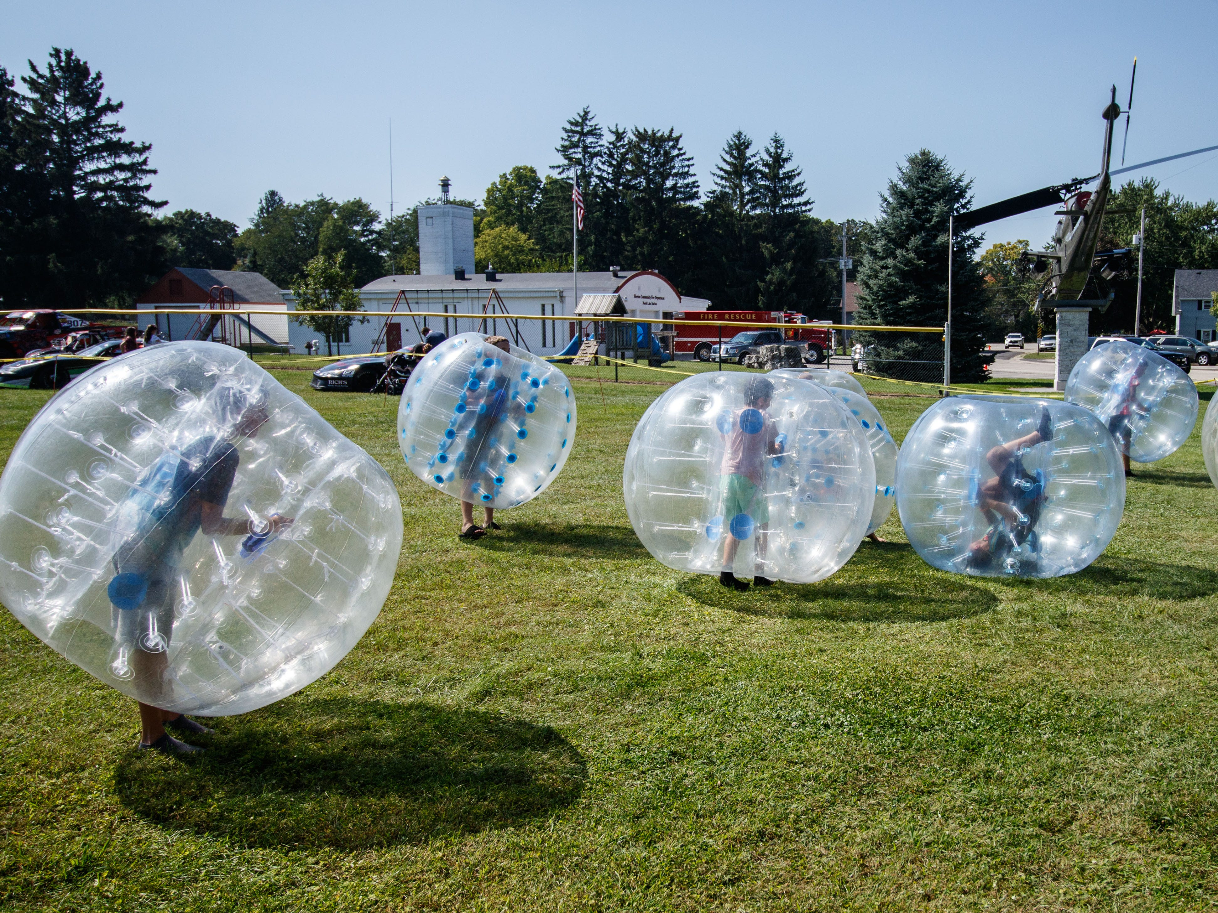 Youngsters play in giant inflatable soccer balls during the annual North Lake Harvest Fest on Saturday, Sept. 15, 2018. The free event includes a parade, vendor market, food trucks, live music, tractor pulls, face painting, kids activities and more.