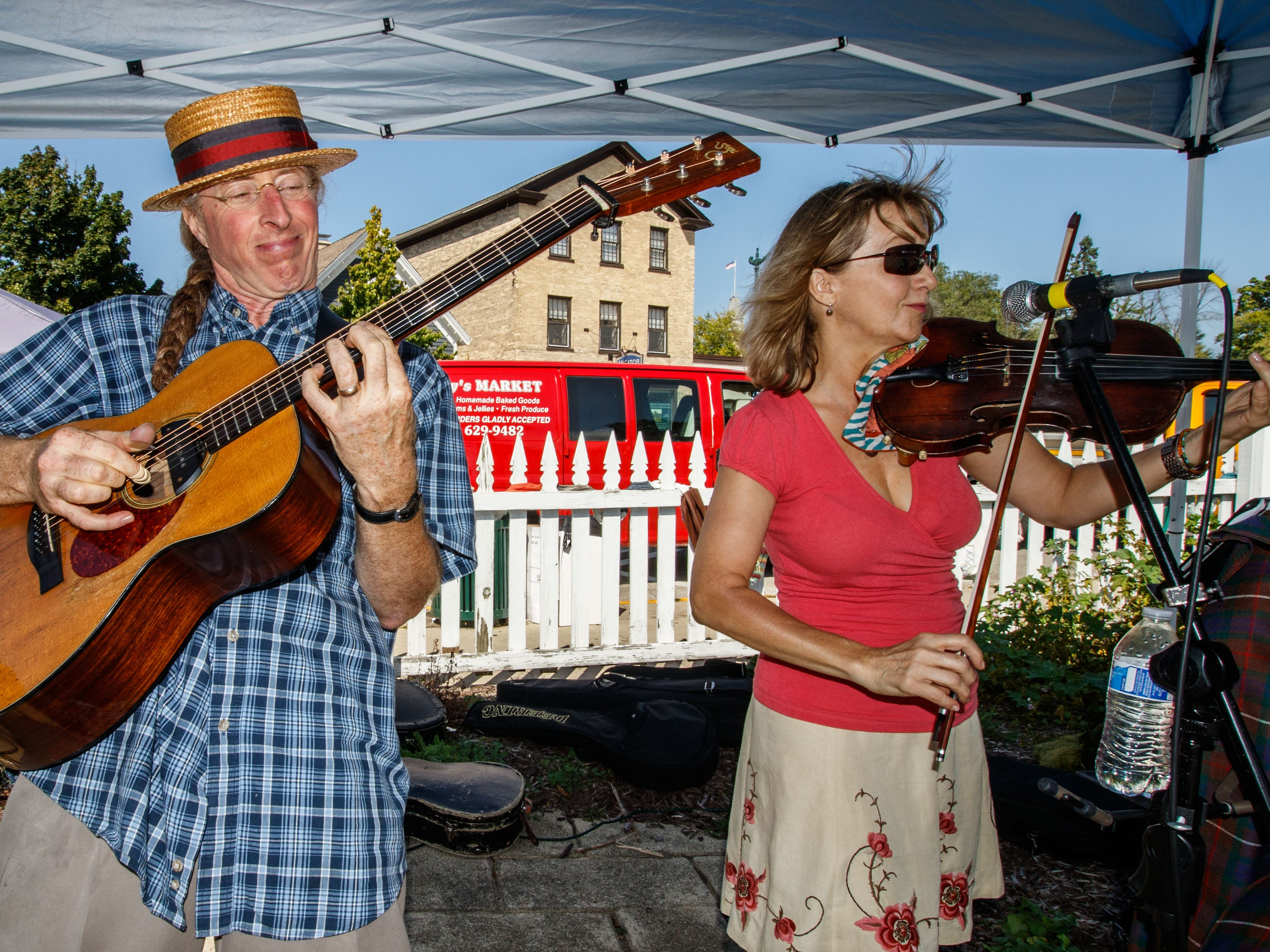 John Nicholson and Susan Nicholson of the band Frogwater entertain visitors during the 46th annual Wine & Harvest Festival in downtown Cedarburg on Sunday, Sept. 16, 2018. The free two-day family-oriented arts and crafts event features homegrown produce, artisan foods, award-winning wines of Cedar Creek Winery, live music, children's activities and much more.