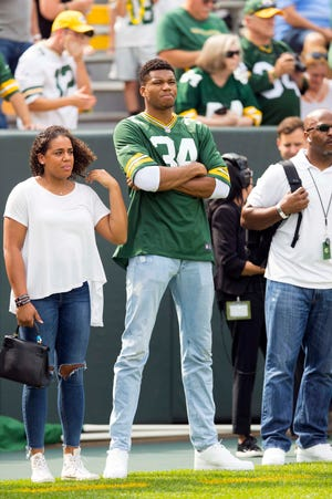 Bucks star Giannis Antetokounmpo takes in his first Packers game on Sunday at Lambeau Field.