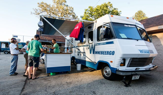 Craft beer enthusiasts visit the Winnebeergo mobile beer garden in Kiwanis Village Park during Pewaukee Parktoberfest on Saturday, Sept. 15, 2018. The event, hosted in conjunction with Pewaukee Park & Rec., runs through October 6 on Friday and Saturday evenings and features live music, food trucks, a rotating selection of 12 different craft beers, games and more.