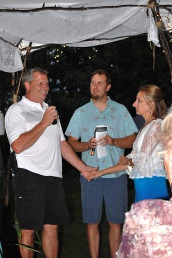 Martin Schmidt officiates at the wedding of Michele Newman and Dave Lindgren, who had placed him for adoption in 1982 when they were teenagers.