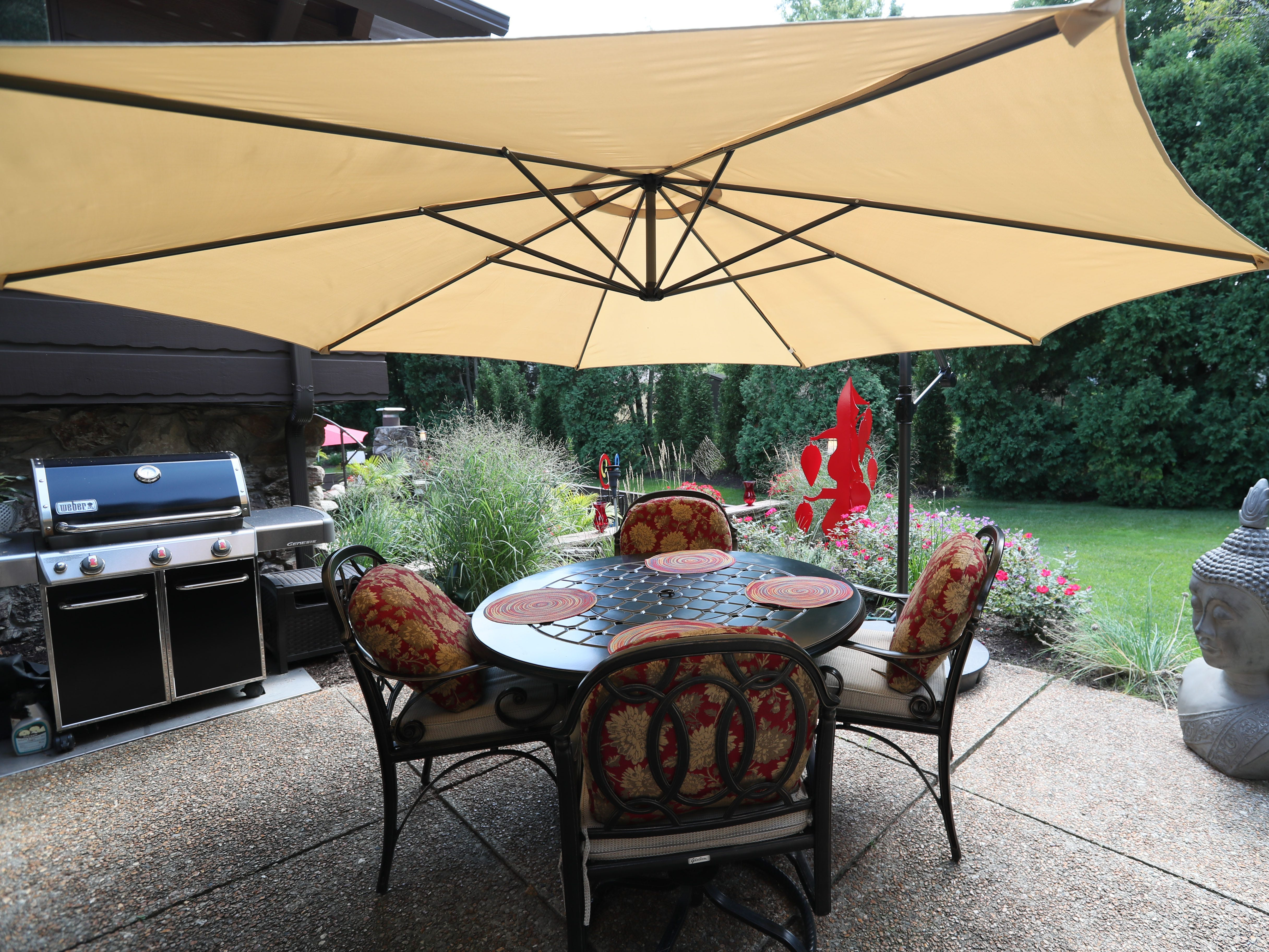 One of four patio areas on the property, this one includes an outdoor grill.