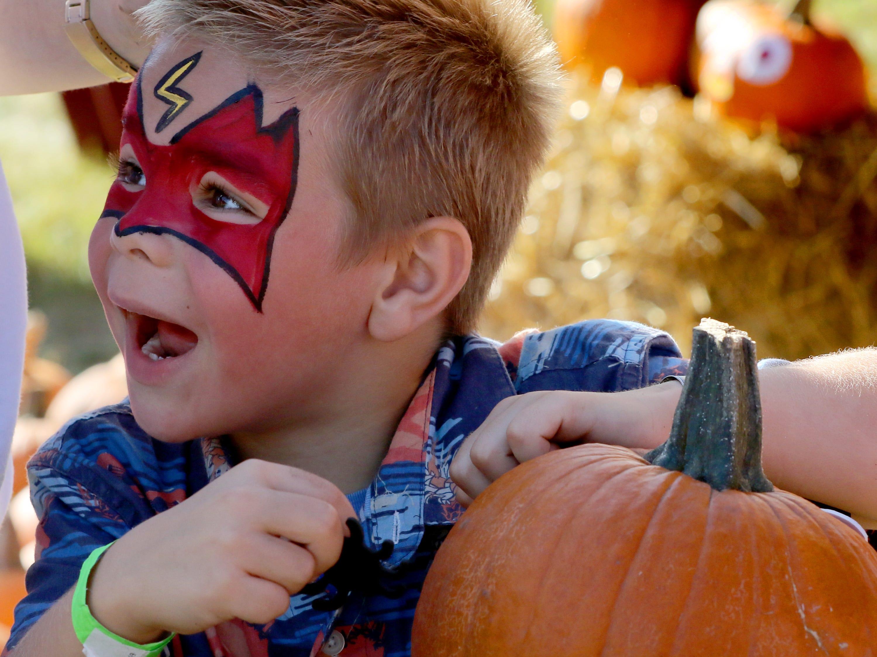 Gabriel Matus, 6, decorates a pumpkin during St. Joseph Catholic Parish's Oktoberfest in Wauwatosa on Sept. 15.