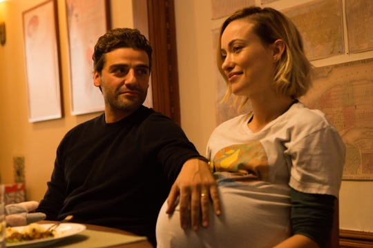 "Oscar Isaac (left) and Olivia Wilde focus on the meaning of ""Life Itself."""