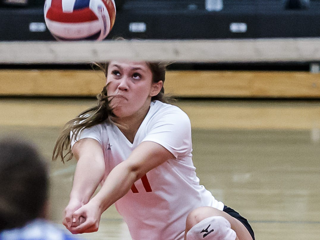 Pewaukee's Ally Longden (11) bumps during the championship match against Notre Dame Academy in the Lady Pirate Invitational at Pewaukee on Saturday, Sept. 15, 2018.