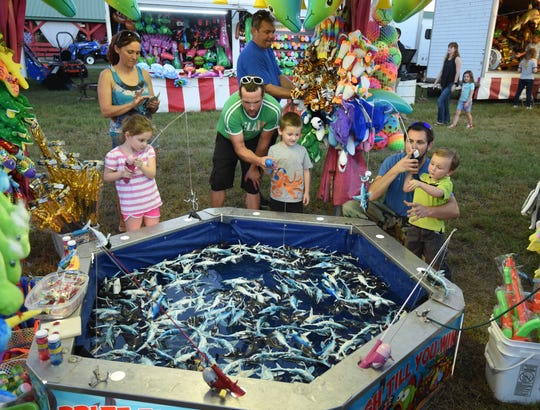 Young Baxter County Fair attendees fish for prizes Thursday night.