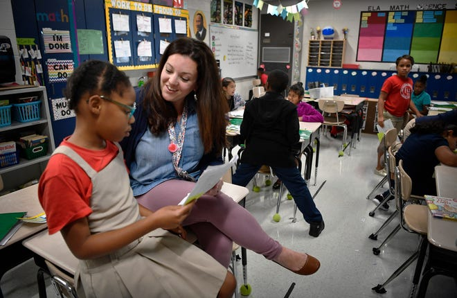 Jiff Burnell encourages Syrai Alexander after reading her writing assignment at Fall Hamilton Elementary Thursday Sept. 13, 2018, in Nashville, Tenn.