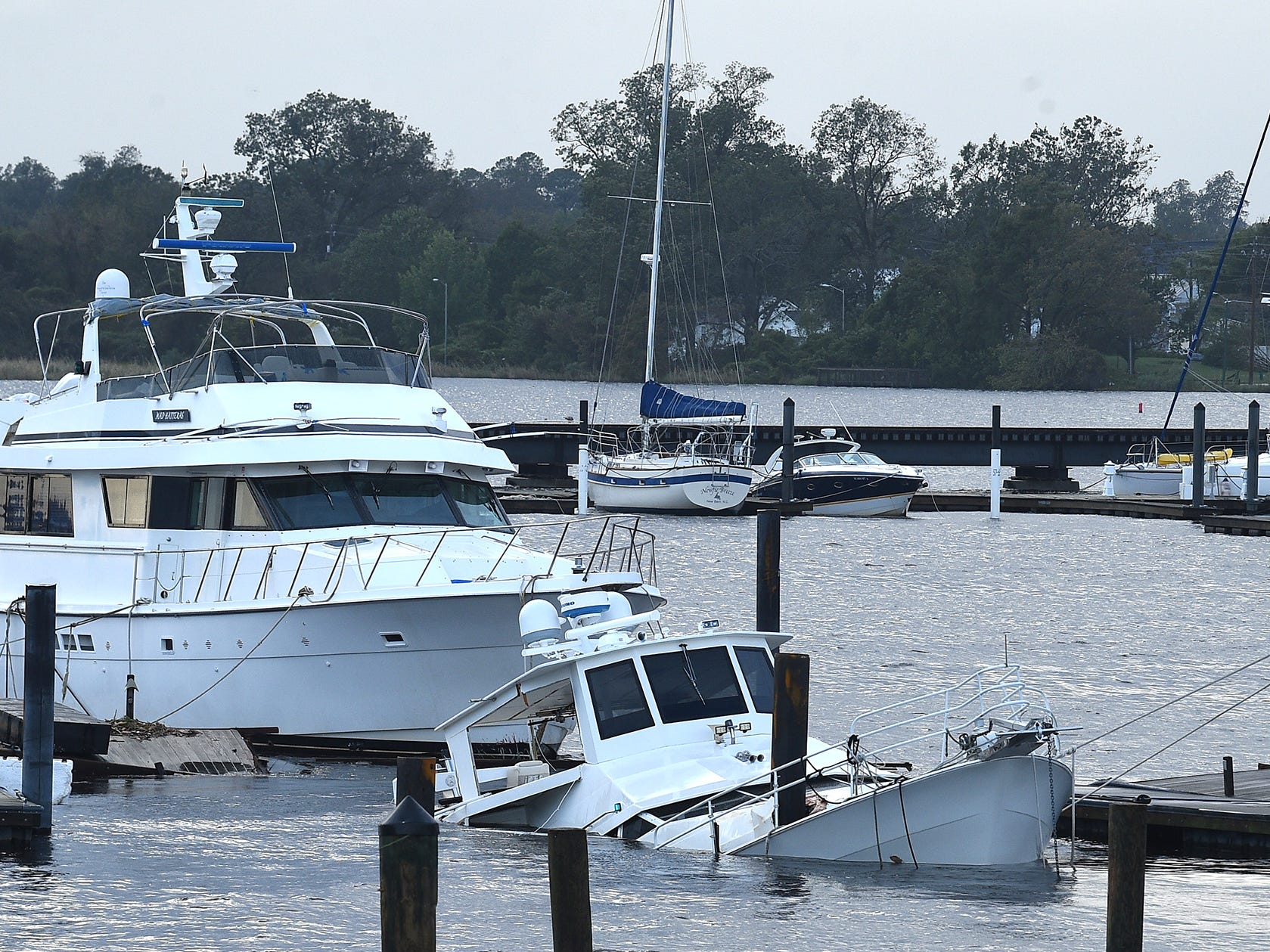 Some boats at a marina in New Bern, N.C., have been damaged by flooding and high winds from Hurricane Florence.