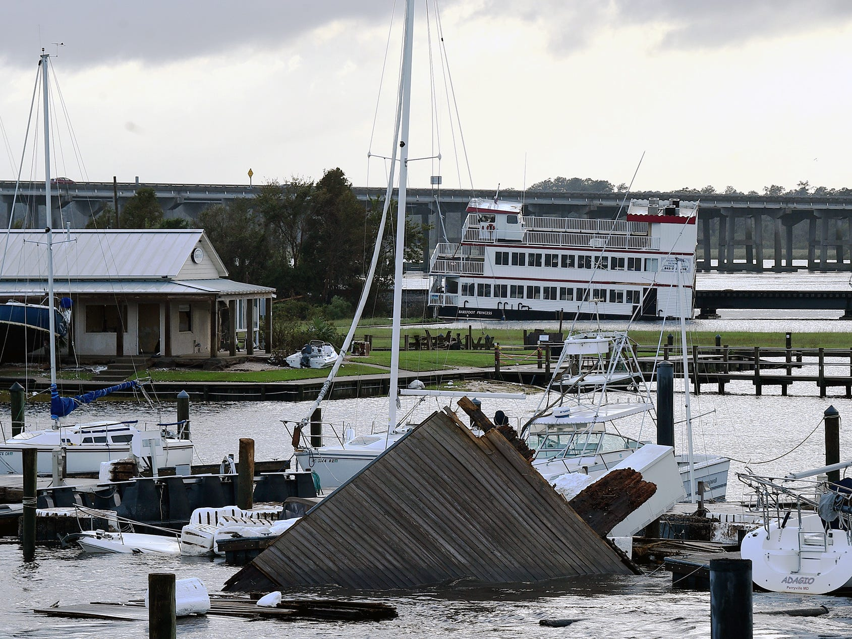 Some boats have been damaged by flooding and high winds at a marina at New Bern, N.C.