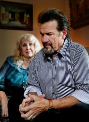 Veteran Christian artist Russ Taff, right, talks about his childhood and his lifelong struggles with alcoholism, at his Bell Buckle home on Sept. 14 as his wife Tori Taff, left, listens to his story.
